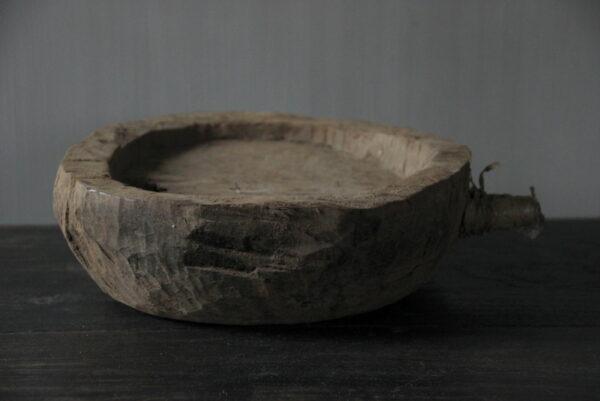 Oude houten vijzel